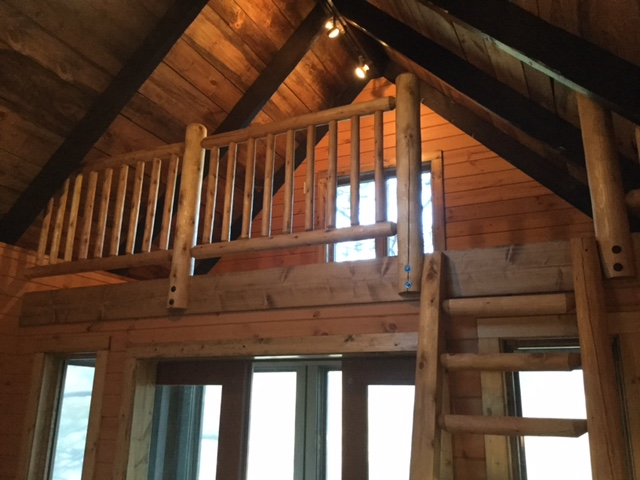 Log railing in tree house loft